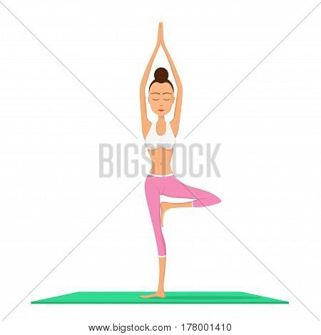 young fit woman performing vrikshasana on green mat, yoga and meditation concept