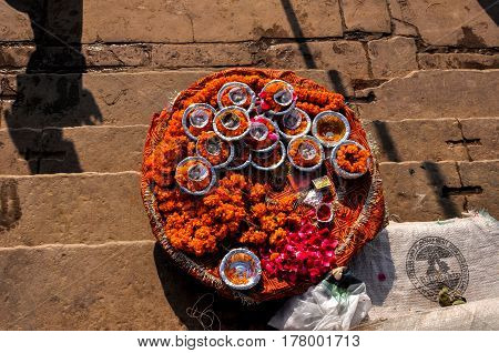 Varanasi, Uttar Pradesh, India- September 3, 2013: Hindu devotees use marigold and rose flowers , cotton, ghee, sweets and red powder for daily prayer at Varanasi, Uttar Pradesh, India.
