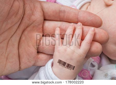 Genetic Clone Concept. Man Is Holding Hand Of A Baby With Bar Co
