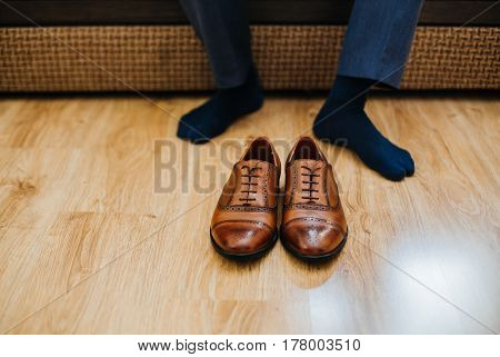 Business man dressing up with classic elegant shoes.
