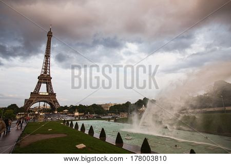 Fountains in Paris at the Trocadero square near the Palace of Chaillot. Travel through Europe. Attractions in Paris. The gray sky above the Eiffel Tower in Paris. Beautiful fountains in Paris. A wonderful view of the Eiffel Tower in Paris