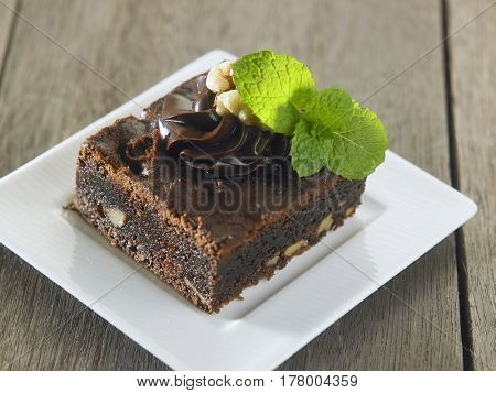 delicious brownie with walnut on the wooden background