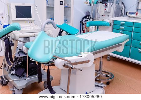 Gynecological Surgery Room With Chair And Equipment In Reproductive Medicine Clinic. Selective Focus