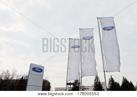 Kiev, Ukraine - March 22, 2017: Ford  Logo On Flags Near Ford Car Selling And Service Center.