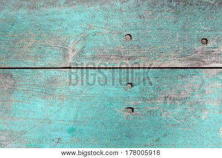 Wooden planks in the old blue paint