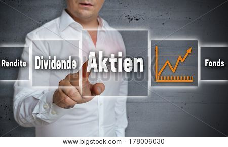 Aktien (in Germn Shares, Dividend, Yield, Fund) Concept Background Is Shown By Man