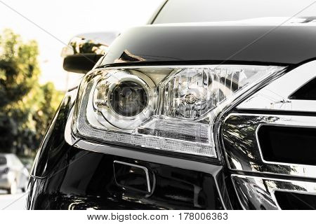 Close up front lighting SUV car with light effect color