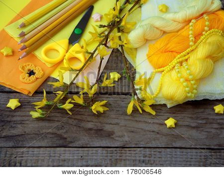 Composition Of Yellow Accessories For Hobby On Grey Wooden Background. Knitting, Needlework, Sewing,