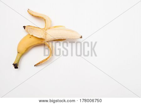 Half-peeled Banana On A White Background.