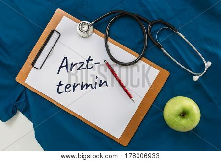 Arzttermin (in german Medical appointment) Clipboard with stethoscope.