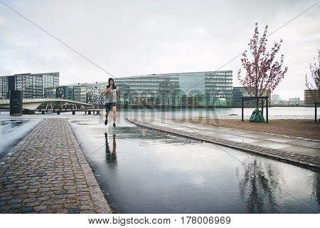 Man Running In City After Rain