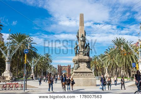 BARCELONA SPAIN - OCTOBER 22 2015: Tourists walking on Passeig de Lluis Companys promenade in Barcelona the capital city of the autonomous community of Catalonia in the Kingdom of Spain