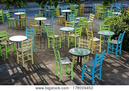 Tables and chairs of a traditional coffee bar in the city of Konitsa in Epirus, Greece