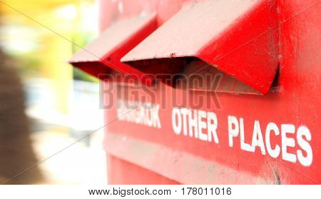 Bangkok Thailand postbox red color Photo macro focus select at cover the channel cap has abrasions around are blur.