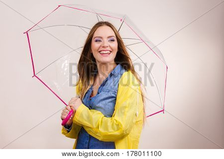 Woman Wearing Waterproof Coat Under Umbrella