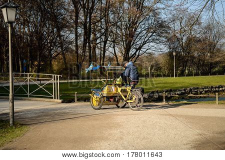 Munich,Germany,March 23,2017:A riksha driver waits for clients in the Englischer Garten park