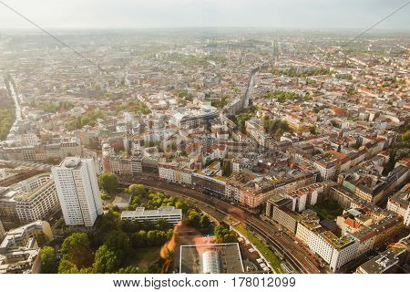 Travel to Germany. View of the houses and streets of Berlin with a bird's-eye view. Overcast sky in Berlin. Light from the sun on the houses in Berlin. Residential houses in Berlin. Megapolis. European city Berlin