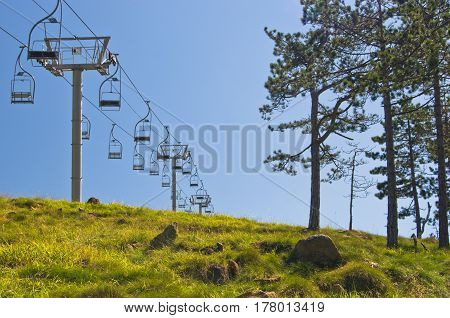 Ropeway at Divcibare mountain against blue sky, west Serbia