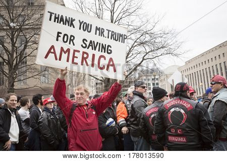 45th Presidential Inauguration, Donald Trump: Thank You Mr Trump For Saving America on a sign held by a supporter outside the security checkpoint, WASHINGTON DC - JAN 20 2017