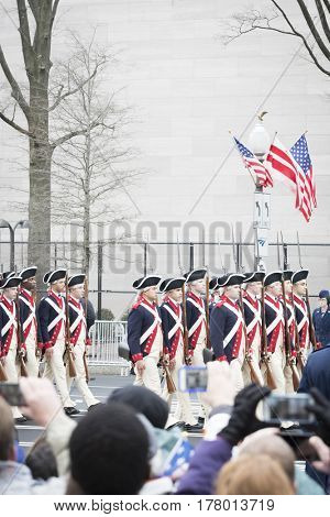 45th Presidential Inauguration, Donald Trump: US Army personnel wearing Revolutionary War uniforms march in the Presidential Parade on Pennsylvania Ave in NW, WASHINGTON DC - JAN 20 2017