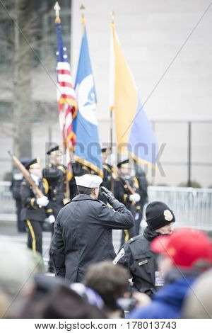 45th Presidential Inauguration Donald Trump: Armed Forces personnel salute as flags of a ceremonial Honor Guard pass by in the Presidential Parade on Pennsylvania Ave in NW WASHINGTON DC - JAN 20 2017