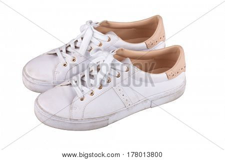 Dirty sneakers isolated on white