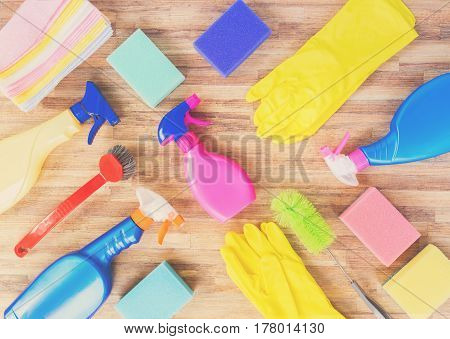 Spring cleaning concept - colorful sprays bottles and rubbers pattern, retro toned