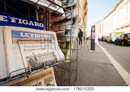 PARIS FRANCE - MAR 23 2017: Le Figaro French magazine newspaper from press kiosk newsstand featuring headlines following the terrorist incident in London at the Westminster Bridge