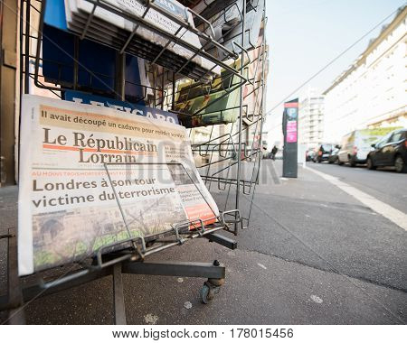 PARIS FRANCE - MAR 23 2017: Le Republicain Lorrain French newspaper from press kiosk newsstand featuring headlines following the terrorist incident in London at the Westminster Bridge