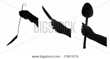 Hand Holds Kitchen Tools. Set