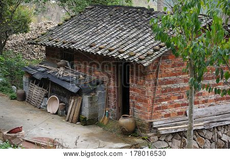 Old brick shed in Chinese village with tile roof