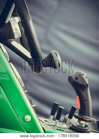Agriculture equipment agribusiness machinery and vehicles concept. Operating system on big industrial agricultural machine