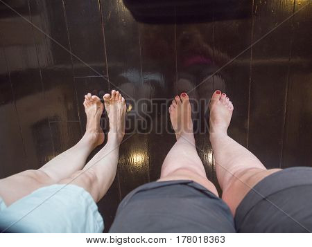 Two women in Japanese museum without the shoes