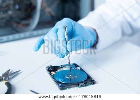 Lab Engineer Working On Broken Hard Disk