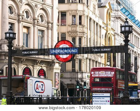 London 20 March 2017: United Kingdom: Piccadilly Circus underground station in London. Traffic with red double-decker bus in one of the most famous streets in London