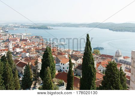 view of the beautiful European city of Sibenik in Croatia Adriatic sea houses with red roofs summer ships sightseeing city playground