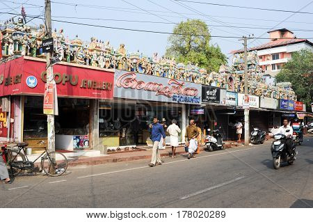 Alleppey India - 21 January 2015: People walking on the street in front of a indu temple at Alleppey India