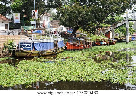 Alleppey, India - 21 January 2015:Boats cruising on a canal of Alleppey India