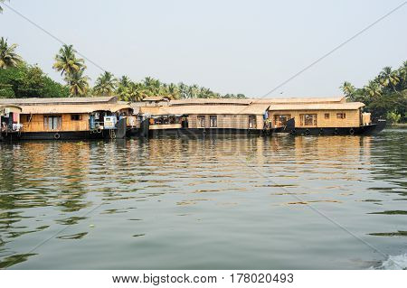 Alleppey, India - 21 January 2015: Traditional Indian houseboat cruising near Alleppey on Kerala backwaters