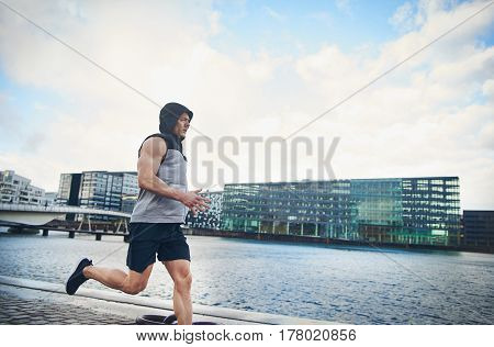 Side View Of Athlete Jogging