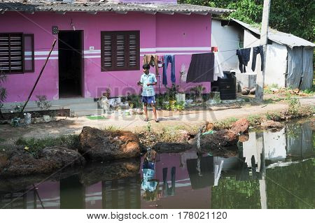 Man In Front Of His House Near Kollam