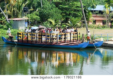 Kollam India - 20 January 2015: People on a ferry near Kollam on Kerala backwaters India