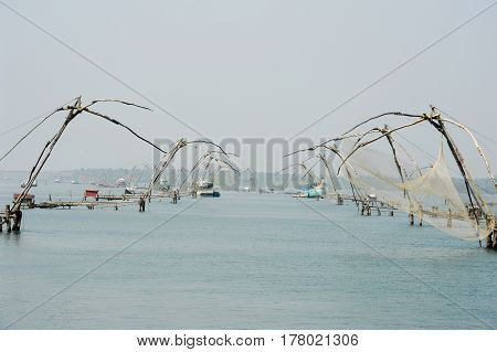 Kollam, India - 20 January 2015: Chinese fishing net on the backwaters the way from Kollam to Alleppey on Kerala India