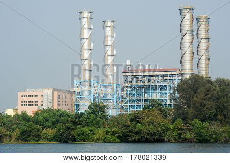 Kollam, India - 20 January 2015: Heavy industry on the backwaters the way from Kollam to Alleppey on Kerala India