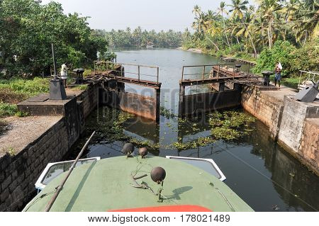 Boat Passing A Barrage On The Way From Kollam To Alleppey