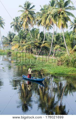 Fisherman Cruising On A Canoe Near Alleppey On Kerala Backwaters
