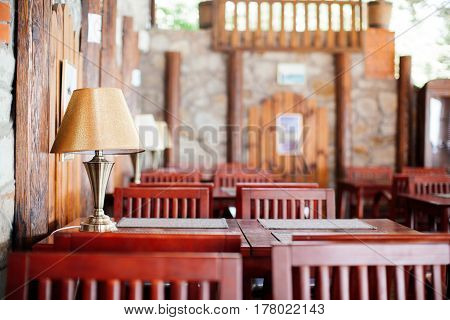 Interior design elements of the restaurant or cafe tables wooden chairs lamps horizontal image beautiful blur