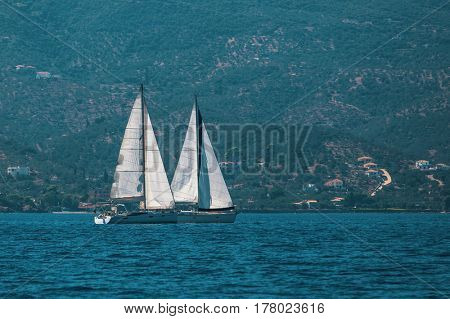 Sailboats at regatta. Sailing at the Aegean Sea.