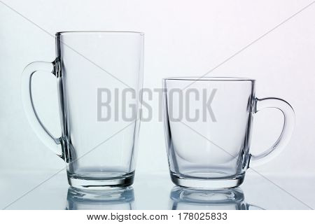 Empty transparent glass coffee and latte mug cup on a table. 11 15 oz comparasion. Product Mock-up