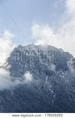 Carpathians Mountains, Bucegi  Range With Cross In Top Of Caraiman Peak, Pine Forest With Fog, Winte